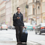 Man walking with a suit case
